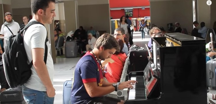Man does amazing piano improv at the Paris train station.