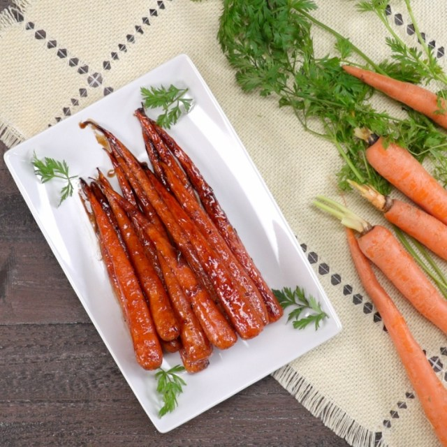 Overhead of honey balsamic carrots on white plate