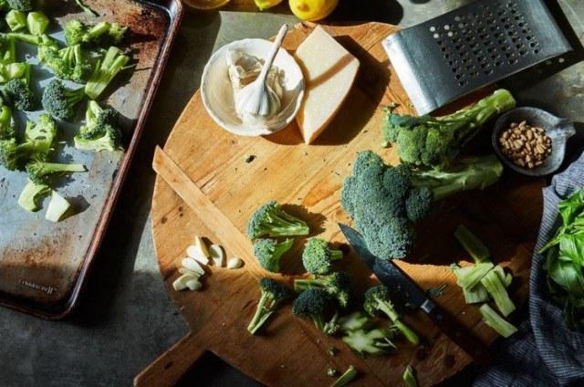 Chopping broccoli florets.