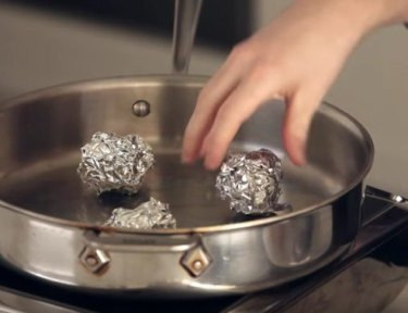Cooking with balls of aluminum foil.