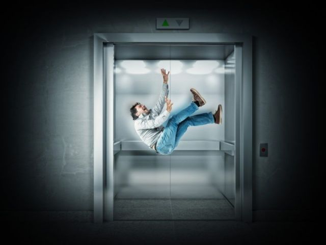 Man free falling in an elevator.