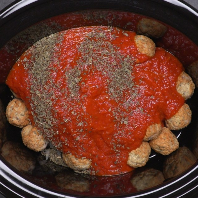 meatballs and tomato sauce and spices in crock pot