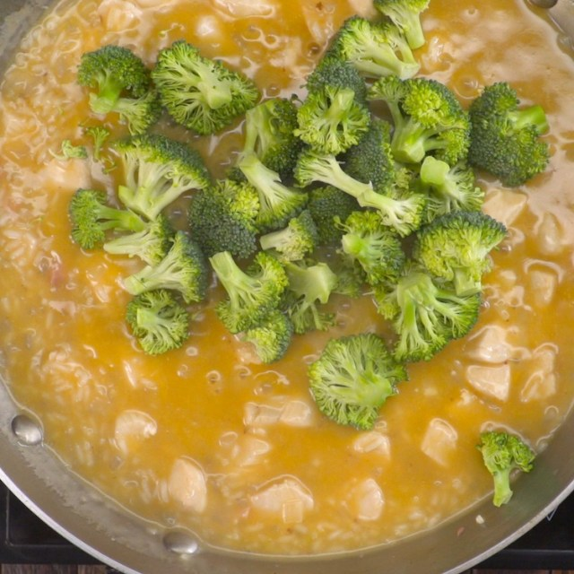 One-pan cheesy chicken broccoli going into pan