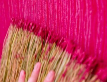 broom painting with hot pink paint