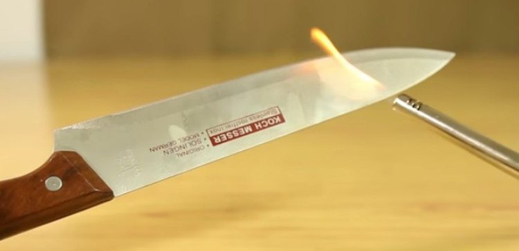 Image of flame on knife spine.