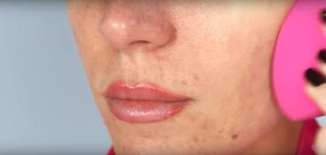 Image of woman applying makeup.