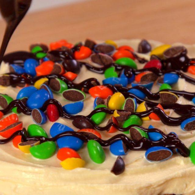 Chocolate Waffle Ice Cream Sandwich M&Ms with hot fudge sundae on top of vanilla ice cream