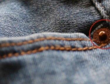 close-up of denim with circle around trivet