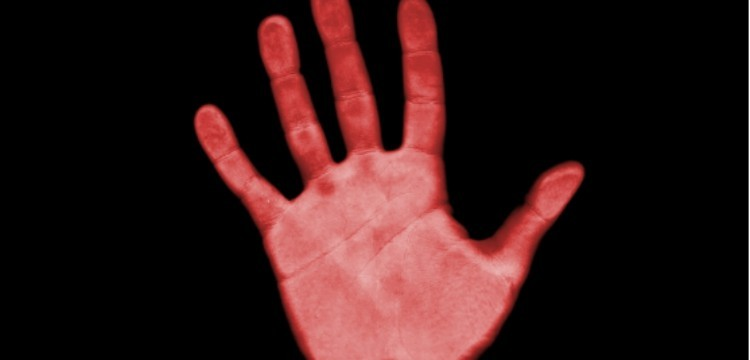 infrared hand against a black background