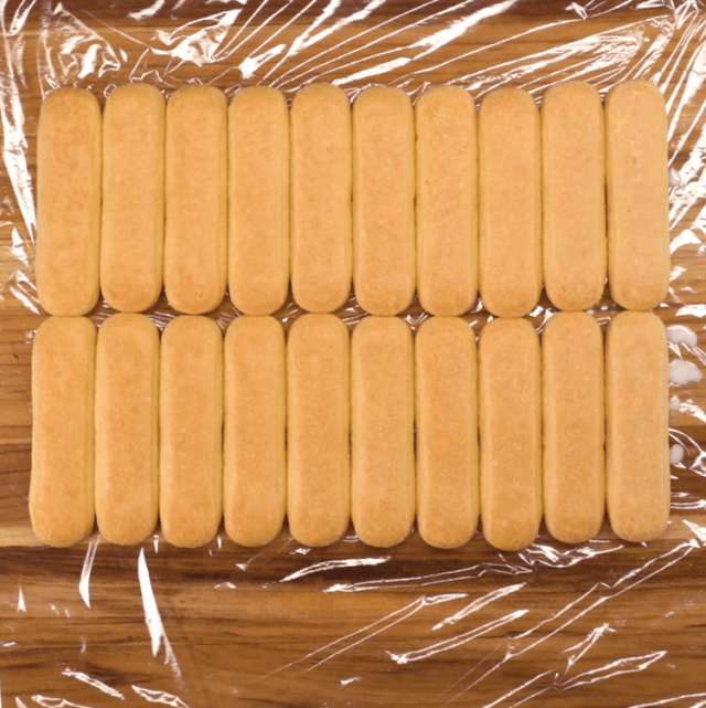 Ladyfinger Roll Cake ladyfinger cookies laid out on plastic wrap
