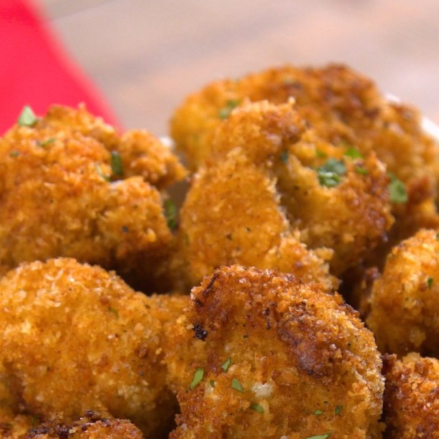 Cheesy, crunchy cauliflower bites with a Cajun kick are a crave-able way to snack on veggies -- and guaranteed to make a cauliflower fan out of anyone.