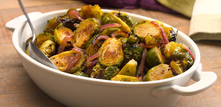 Roasted Brussels sprouts are caramelized in the oven with a bright balsamic & honey glaze, for a colorful veggie side dish that bursts with flavor.