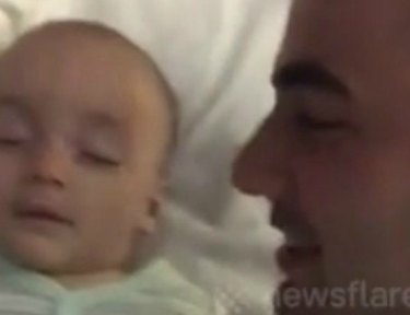 Dad looking at baby.