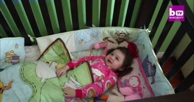 Image of little girl in crib.