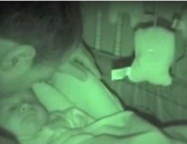 dad kisses sleeping baby