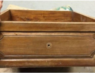 person holding a wooden drawer