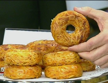 Pic of plate of spaghetti donuts.