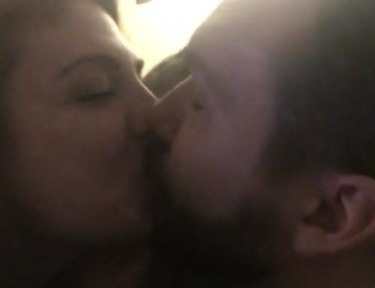Image of 2 parents kissing.