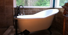 Claw foot slipper tub with bronze trim