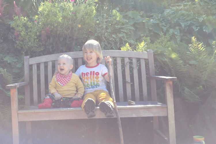 Toby and Gabe on the bench in the new garden