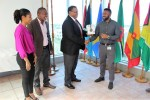 CARICOM ASG Joseph Cox presents the  third prize in the video competition to Mr. Keron Bruce