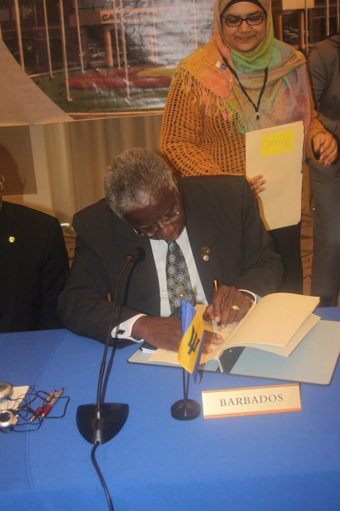 Prime Minister of Barbados, the Hon Freundel Stuart signs the agreement