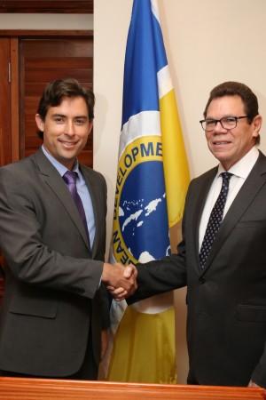 Dr. Warren Smith (right), President, CDB, greets Rafael Ranieri (left), Brazil's Alternate Director to the CDB. (Photo via CDB)