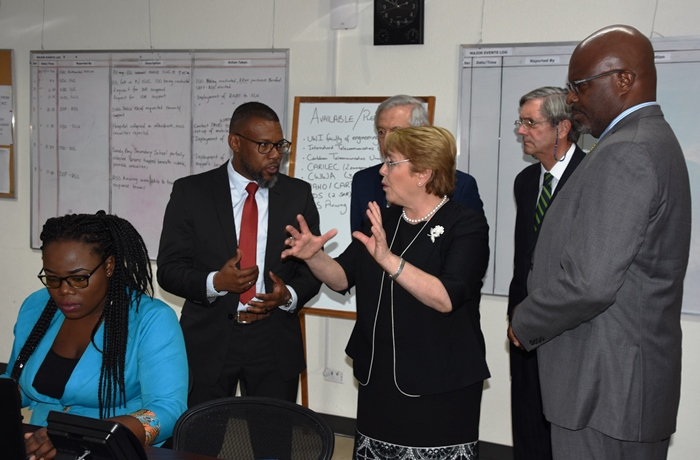 Chile's President, Michelle Bachelet and Executive Director of CDEMA, Ronald Jackson, chatting while on a tour of the Agency's headquarters today. Also pictured is Attorney General and Minister of Home Affairs, Adriel Bratwaite (right). (Phot by A. Gaskin via BGIS)