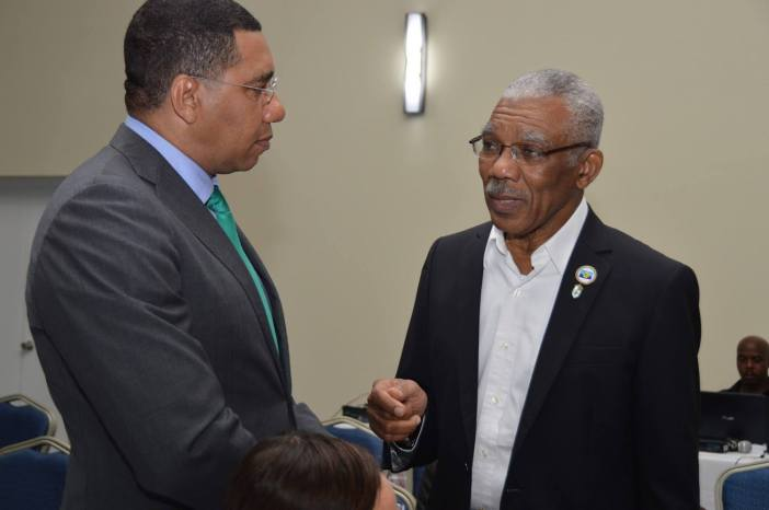 Outgoing Chairman of CARICOM H.E. David Granger (R), interacts with The Hon. Andrew Holness, PM, Jamaica