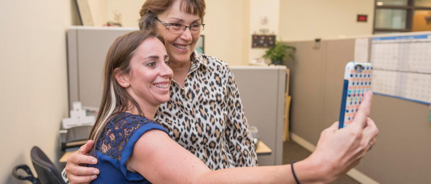 Cassie Shelton (left) takes a selfie with new President Gayle Hutchinson walks around campus to greet staff on her official first day of work on Tuesday, July 5, 2016 in Chico, Calif. (Jason Halley/University Photographer)