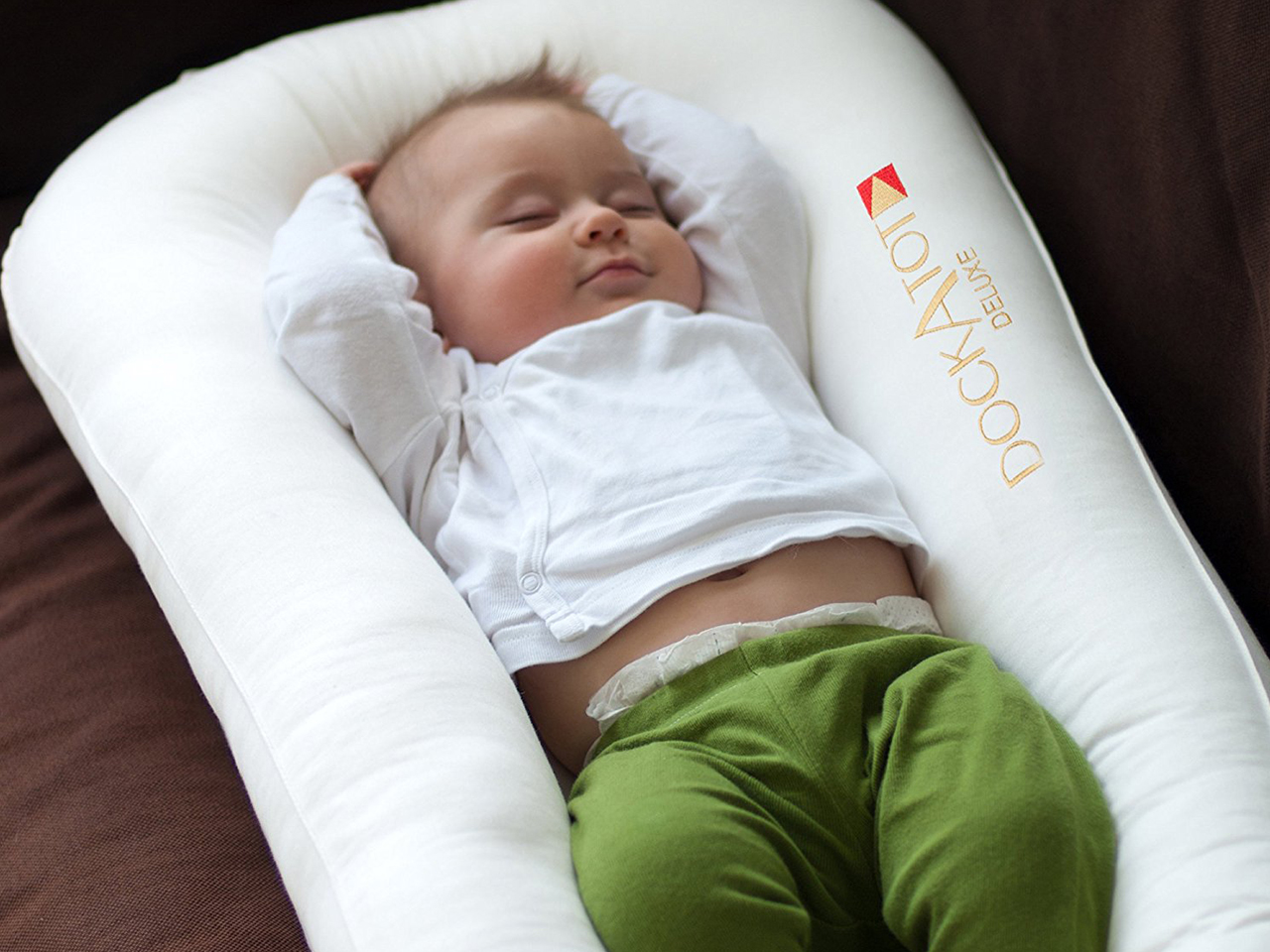 What Can Baby Sleep In Next To Bed The Dangerous Way Parents Are Using Their Dockatots