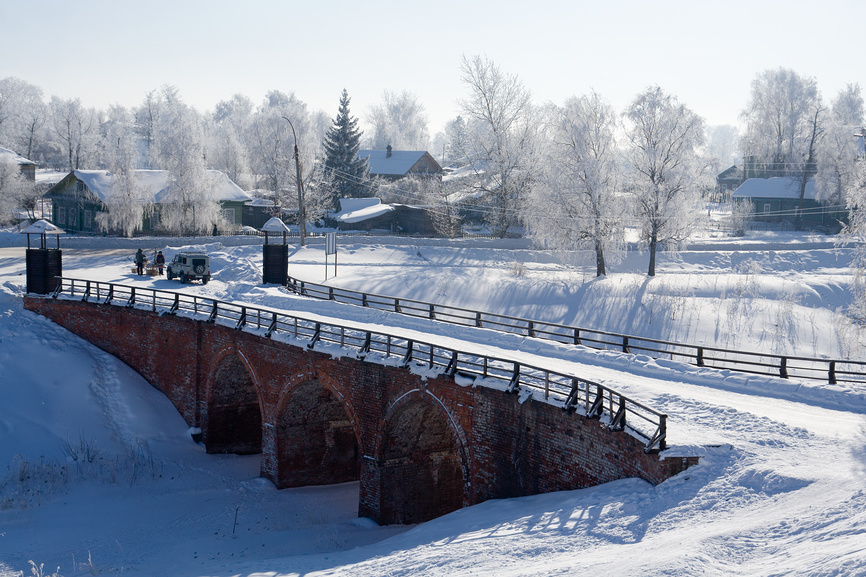Winter in Belozersk. Bridge over the old moat
