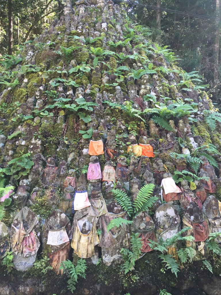 A large mountain of Jizo statues near the lantern storehouse