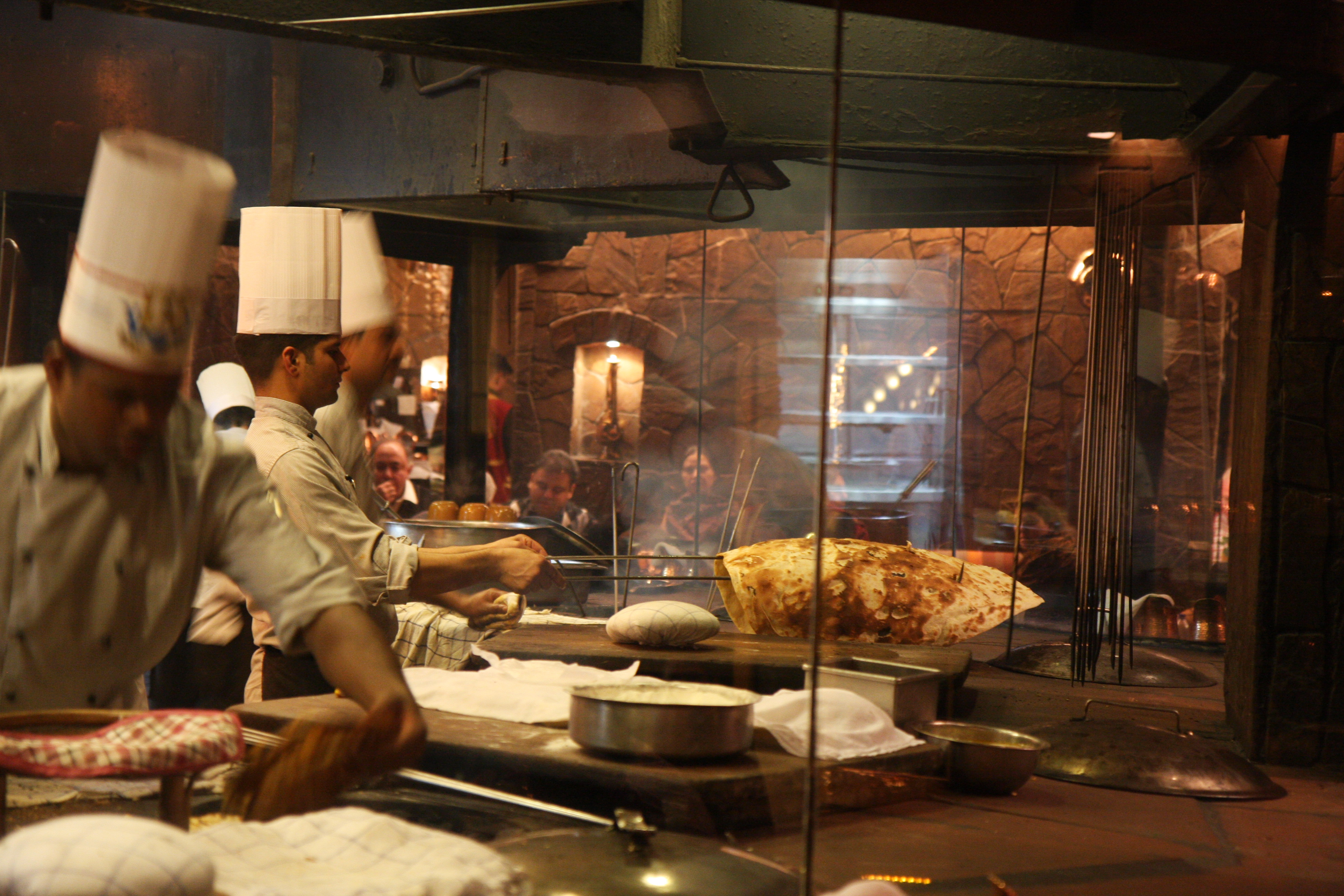 Perhaps the most fascinating feature of bukhara is the large open kitchen where chefs skillfully heave long skewers of marinated meats into the blazing oven