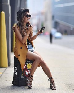strappy heels, mustard vest and belted cutoffs