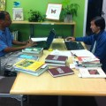 two guys cataloguing in the library