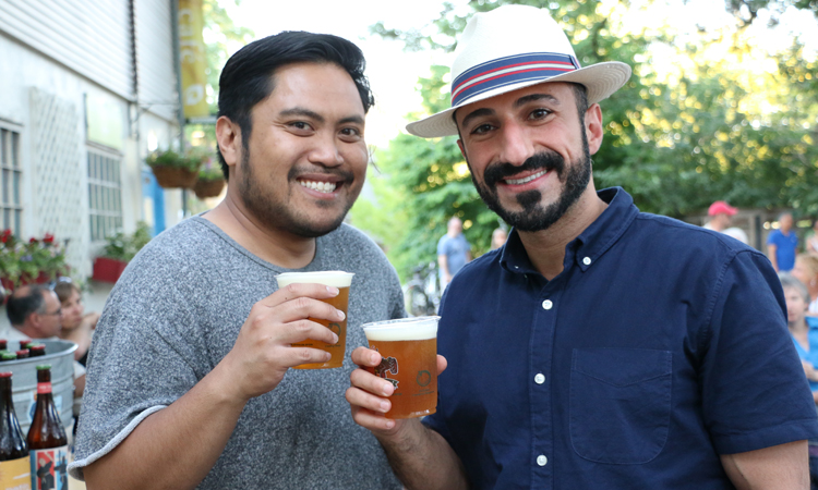 two guys enjoying a beaus beer credit SVP media