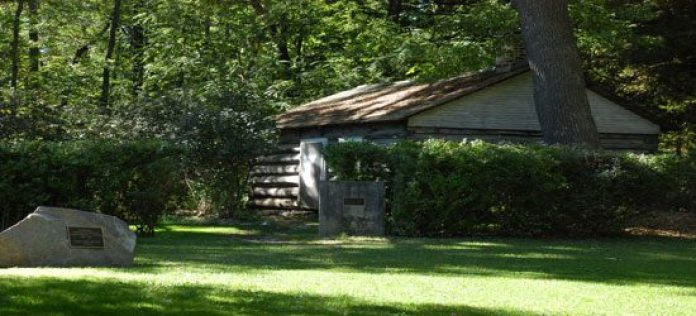 An old house stands in the woods near the property.