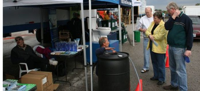 City worker offers tips on water conservation to residents at the Ward 43 Environment Day last Saturday.
