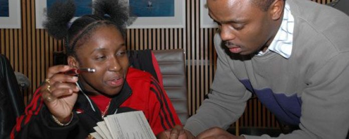 An Imani member shares his knowledge and love of literature with a local high school student.