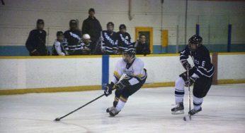 King Academy assistant captain, Phil Janovski #5, wheels defending Porter captain, Jason Gale #6.