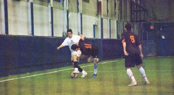 East York's #17 tries to get past Victoria Park Panther #10.