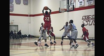 West Hill's Kevon Parchment fakes a shot, and dishes a pass to team-mate Brandon Burke, #32