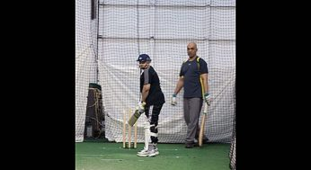 A boy gets batting tips in the Under 15 program at North Star Cricket.