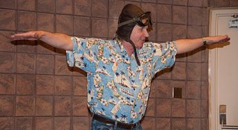 Jim Parker helps the children imagine flying away to an exotic location during a performance at the Malvern Public Library