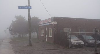 One of the many used-car dealerships along Kingston Road.