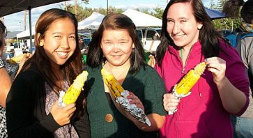 First-year UTSC students Julie Sato (left), Jennifer Struth (centre) and Karen Younghusband came out to the farmers' market to enjoy the free corn. They also checked out the other food samples available at the market, including goat cheese and kettle corn.