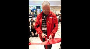Mike Burke helps cut the ribbon at the unveiling of the Scarborough Town Centre's $62-million facelift Nov. 17.