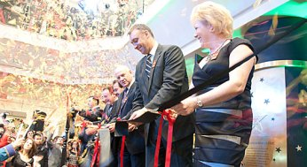 Kathy Meyers, general manager of the Scarborough Town Centre, accompanied by other dignitaries, cuts the ribbon at the Nov. 17 unveiling of the mall's $62-million facelift.