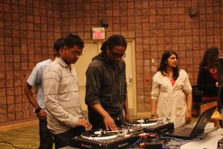 DJ Craig Brooklyn, centre, teaches a student a basic scratching technique during a free March 16 event hosted by Scratch Labs DJ Institute and the Malvern library.